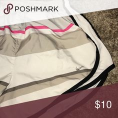 White patterned Nike shorts Shorts in great shape. Initials are written on the inside but not noticeable when worn. Nike Shorts