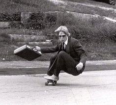 Businessman skateboarding barefoot in 1982