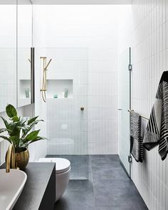 Make your narrow space work harder with a practical design and a smart layout. This bathroom features all the necessities of a modern… Small Narrow Bathroom, Small Bathroom Interior, Master Bathroom Layout, Grey Bathroom Tiles, Bathroom Tile Designs, Modern Bathroom Design, Grey Tiles, Bathroom Ideas, Small Grey Bathrooms