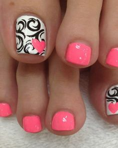 Pink nails with a white accent nail that has black swirls and a pink heart