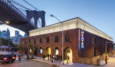 In the cobblestoned, hip neighborhood of DUMBO along the famed Brooklyn Bridge Park, the new St. Ann's Warehouse embraces contradictions.
