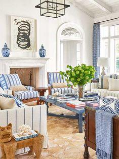 Blue and white striped living room in Palm Beach house on Thou Swell #hometour #palmbeach #livingroom #coastaldecor