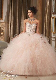 Dazzling and beautiful, you'll love wearing Mori Lee Vizcaya Quinceanera Dress Style 89113 at your Sweet 15 party. Made out of tulle, this Quince dress features a strapless bodice decorated with intri