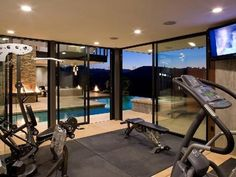 A home gym with a sweet ass view. Very luxurious