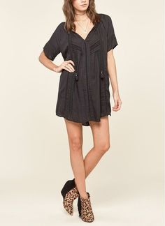 This breezy, tunic-style swing dress features a tassel-tied neckline and tonal lace insets that add sweet embellishment to the playfully short style.