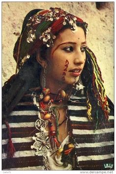 Africa | Portrait of a Berber Amazigh bride with facial tattoos and paintings and a traditional headscarf