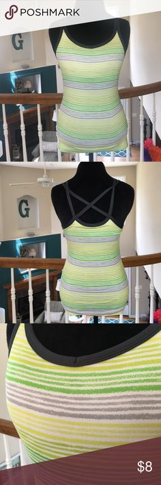 Danskin Now Yoga Tank Top Danskin Now Yoga Tank Top in size small (4-6) in stripes colors of white, green, lime green, yellow and gray with black straps that criss-cross in the back. Danskin Now Tops Tank Tops