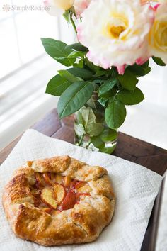 Beautiful Peach Galette! Rustic tart made with slices of fresh yellow peaches in a simple butter crust. So easy to make this free-form tart! On SimplyRecipes.com