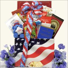 GiftsBeyond.com helps show some pride for America with this patriotic gourmet gift basket. Includes a delicious assortment of gourmet snacks, candy, nuts, cheese, crackers and more. Features Patriotic Swirl Pop and Patriotic Plush Bear with Top Hat holding USA star and is designed in this festive American Flag gift box.Dim: 10L x 8W x 14H  If you have any questions please contact CustomerServiceGiftsBeyond.com