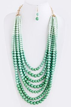 Mint stacked ombre beaded statement necklace with simple little earrings. $24,99, via Etsy. - absolutely breathtaking.  Love the look? Want to make your own? try your own colors for ombre? start by shopping for beautiful and meaningful high-quality natural gemstone beads from dakotastones.com