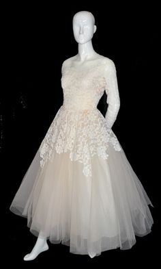 1950s William Cahill Beverly Hills slightly blushed wedding gown in tulle with lace on top.