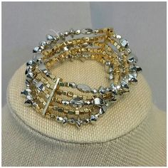 Goldtone and Silvertone Multi-Shaped Bead Bracelet Goldtone and Silvertone Multi-Shaped Bead Bracelet, one goldtone bar on each side, stretchy, lightweight, New With Tag, in plastic and bubble wrap. Super cute!  Eligible for 20% discount when Bundled! Jewelry Bracelets