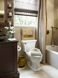 Love the mosaic tiles over vanity and big neutral in shower