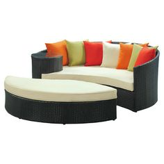 From Wayfair, Taiji Daybed and Ottoman Set in espresso. On sale.