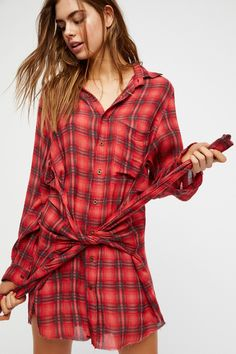 "Grunge Mini Dress | Inspired by decades past, this lightweight plaid mini dress is featured in an oversized and shapeless silhouette.  * Button closures down the front * Sleeve detail at the waist for a natural ""tie around the waist"" look"