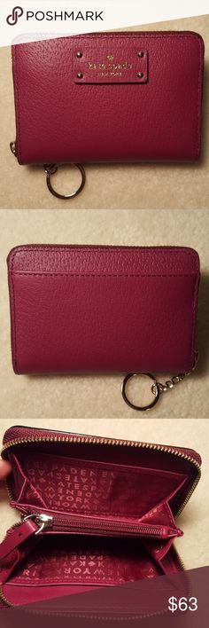 Kate Spade Wallet Kate Spade Grove Street Dani wallet with attached keyring.This cute wallet measures approx 4 1/2 X 3 1/4. Kate Spade Bags Wallets