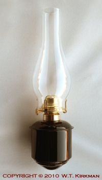 W.T. Kirkman No. 2525S Caboose Wall Lamp.  This pretty oil lamp is wall-mounted for electricity-free indoor light.  I'll use a kerosene/paraffin mix in it.