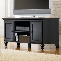 Keep your television and accessories easily accessible and out of the way of walkers with this wooden TV console. The console can hold up to a 52-inch television on top and contains multiple shelves for items such as gaming consoles or video players.