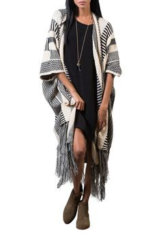 This knit fringe kimono is a fall staple! Essential for your holiday travels and the cozy nights spent in.   Knit Fringe Kimono by PPLA Clothing. Clothing - Sweaters - Cardigans Georgia