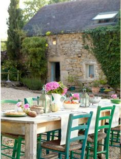 from pink wallpaper: love the rustic table with the green chairs.