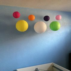 Use paper lanterns hang them from ceiling to decorate teen room