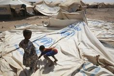 Malian #refugee children play on a partially erected tent in Mentao, a day after arriving at the site. ©UNHCR/B.Sokol