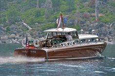 """""""Thunderbird"""" The largest and undoubtedly the most elegant of all gasoline powered, mahogany hulled """"woodies"""" to grace the waters of Lake Tahoe is the Thunderbird. Designed for real estate tycoon """"Captain"""" George Whittell, Jr., by naval architect John Hacker in Michigan, this 55' marine masterpiece was built by Huskin Boat Works in Detroit. Whittell's love of aircraft is evident in the graceful turn of the riveted, brushed stainless steel cabin of the yacht..."""