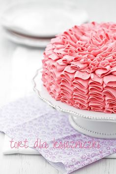 This pink ruffle cake is so pretty.  I have no idea what the recipe says, but it's adorable.