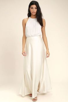 The Picture Perfect Cream Satin Maxi Skirt is a romantic's dream! Woven poly with a satiny sheen forms a high, banded waist (with elastic at back for fit) atop a flaring maxi skirt. Hidden back zipper.