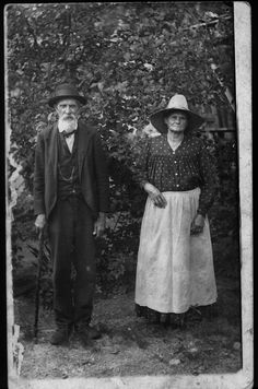 Samuel and America Hilterbrand, standing in yard.  Sam has a cane, America has a straw hat.  Ellsinore, Carter County, Missouri, circa early 1920's  Postcard. I love this picture.!
