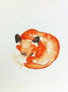 A cute watercolor fox tattoo idea.