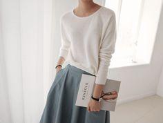 White shirt, gray skirt.