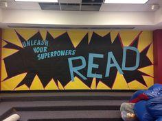 Superhero bulletin board in library