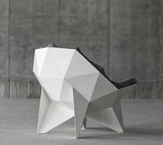 This is a geometric form of a chair. The chair uses triangles throughout its design. The chair still allows its function of a subject being able to sit in it. To some this may be cool and different and to some not visually pleasing.