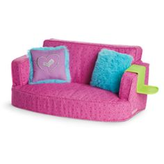 It's a comfy place for doll friends to relax. This soft couch has a pretty pink print and room for two dolls to sit. The set includes: •A comfy couch •Two reversible pillows with furry blue fabric on