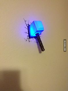 Want. Yes, yes, I definitely want a lamp that looks like Thor left his hammer in my wall. Can I have it in yellow?