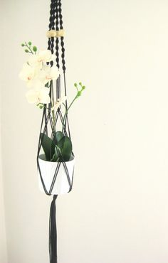 Long modern macrame plant hanger with wood bead accents available at Modern Twist on Etsy