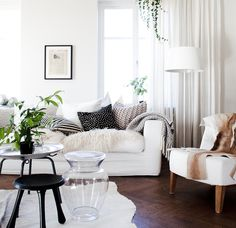 White living room with accent furs and textures