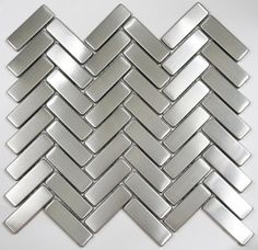 Herringbone stainless steel backsplash tile. Would like nice with navy cabinets and white quartz counters.
