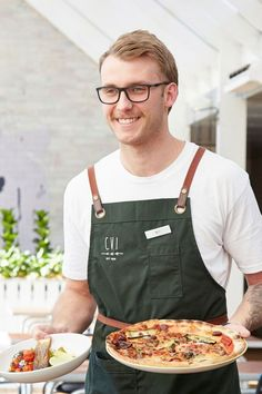 The Camden Valley Inn is a beautiful restaurant and hotel space an hour south of Sydney. The venue offers the perfect breath of fresh country air & light bright styling for any Sydney event, while the staff look fresh and professional in plain white tees with our Tom Bib Apron in Forest Green to match the country setting | Restaurant Uniform | Restaurant Design Ideas | Sever Uniform Ideas | Country Restaurant