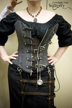 steampunk corset I made this! www.scoundrelleskeep.com ...corset on top of corset, playing around backstage at the DragonCon fashion show, 2009ish.