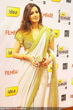 Sonali Bendre in a gorgeous Abu Sandeep @AJSKOfficial http://www.abusandeep.com/ #Saree with heavy gold border & blouse at 57th Filmfare Awards, 2012