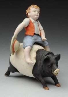Lot # : 1256 - Boy Riding Pig Candy Container.