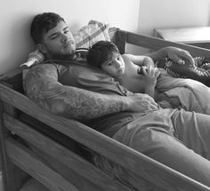 Colin Wayne.  Bet his son thinks his daddy's cuddles are the best!