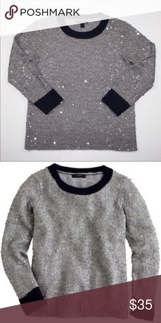 J. Crew Scattered Sequins Sweater Materials: 50% Acrylic, 40% Wool and 10% Mohair   Color: Gray with navy blue collar and sleeve trim as shown in photo.  Size: Medium.  Brand new without tags, bought it because I loved it but decided it wasn't for me. J. Crew Sweaters