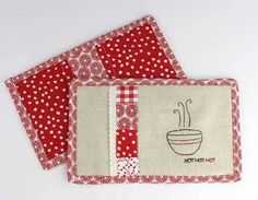 This free tutorial shows you how make a super cute set of hot pads that double as oven mitts! It embraces three techniques - patchwork, embroidery and Zakk