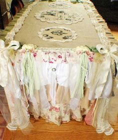 Burlap Table Runner With Shabby Edging of Tied-Off Lengths of Ribbon, Lace, and Pearls