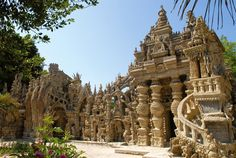 East facade of Ferdinand Cheval's Palais Ideal in Hautrives, France. The French postman (1836-1924) spent 33 years collecting stones on his postal route & using them nightly to construct his home. Wow. via the historical property's official site