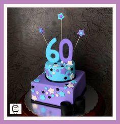 PURPULE AND TURQUOISE FONDANT BIRTHDAY CAKE DECORATED WITH STARS. (Pastel de cumpleaños en color morado y azul turquesa con decoración de estrellas)