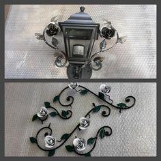 Lampada da esterno a disegno del cliente in ferro battuto. Finitura Nero con rose bianche.